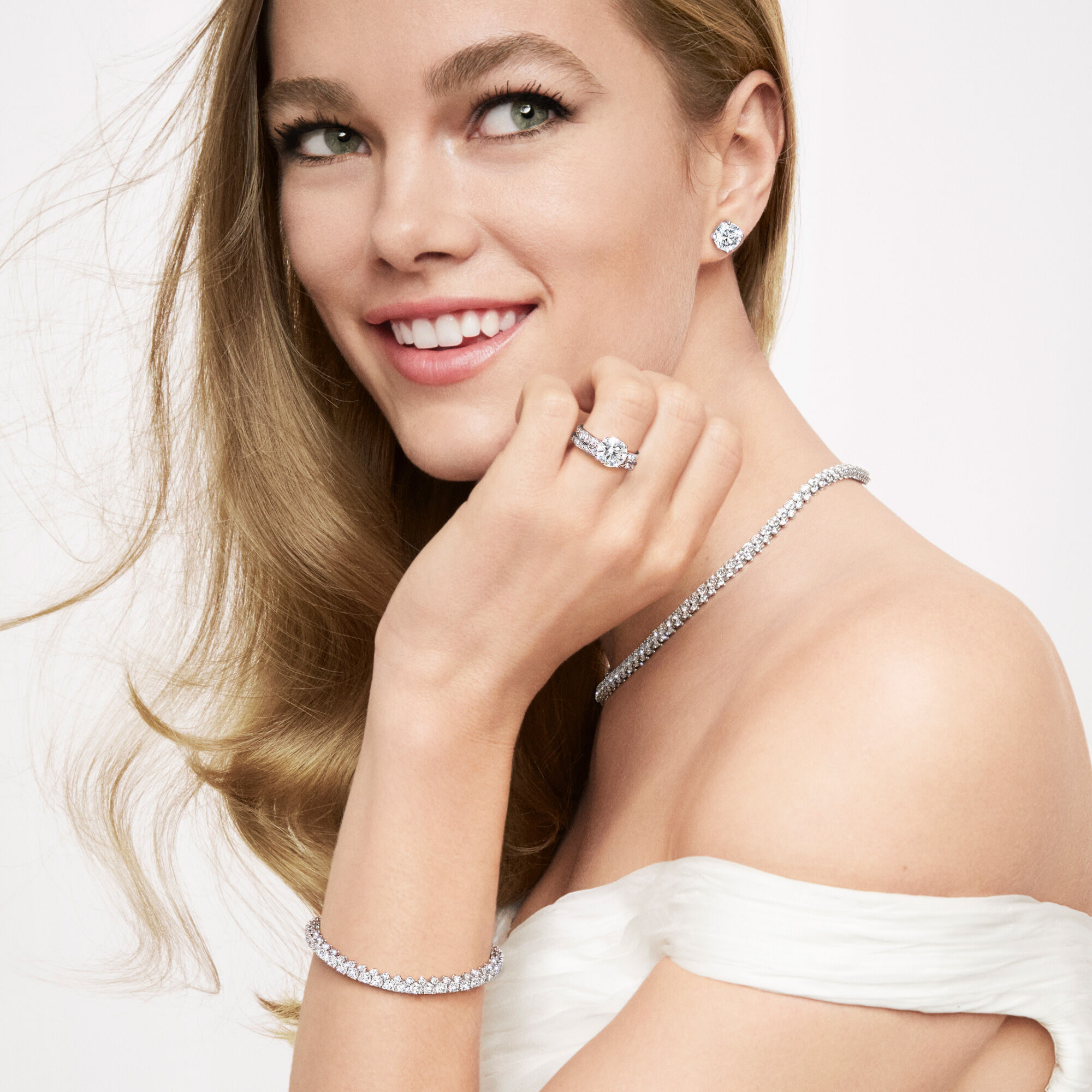 Close up of a model wearing Graff bridal collection diamond jewellery and engagement ring