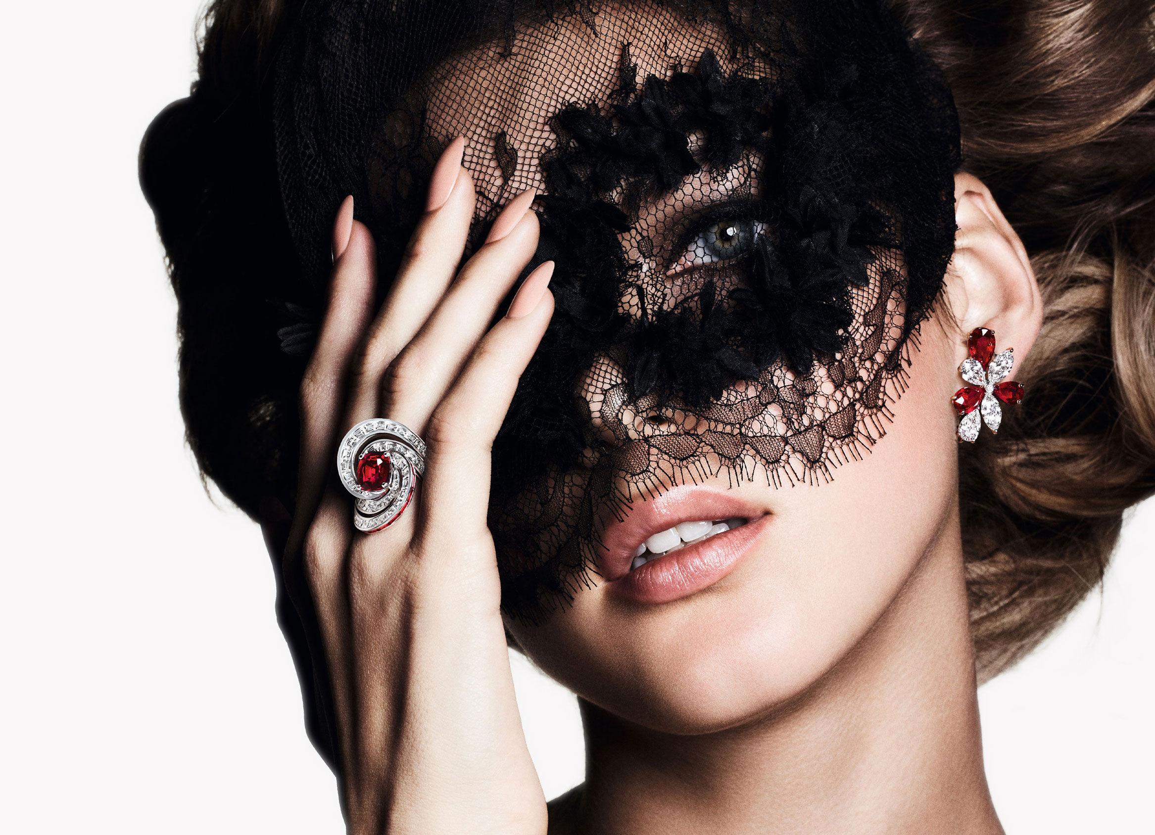 Model wears Graff ruby and white diamond high jewellery