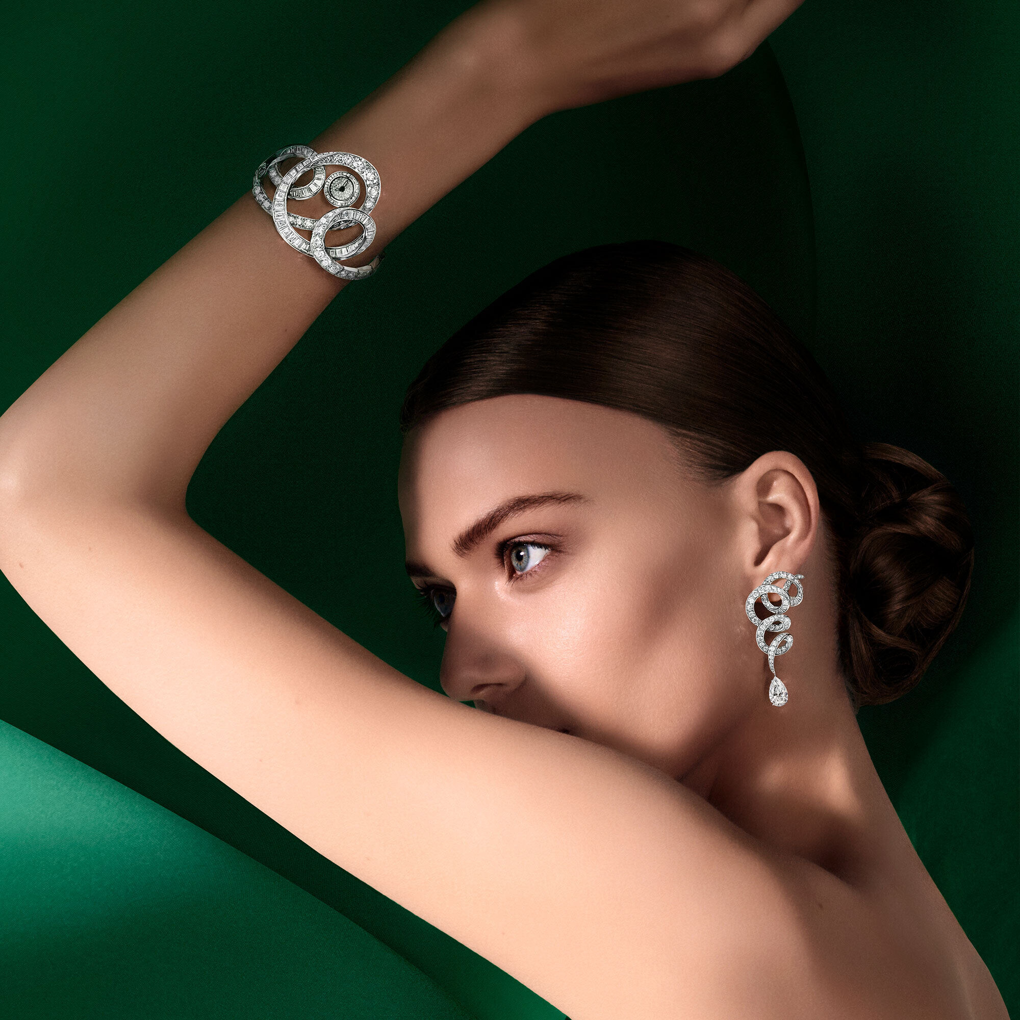 Model wears a diamond watch and earrings from the Inspired by Twombly jewellery collection from Graff