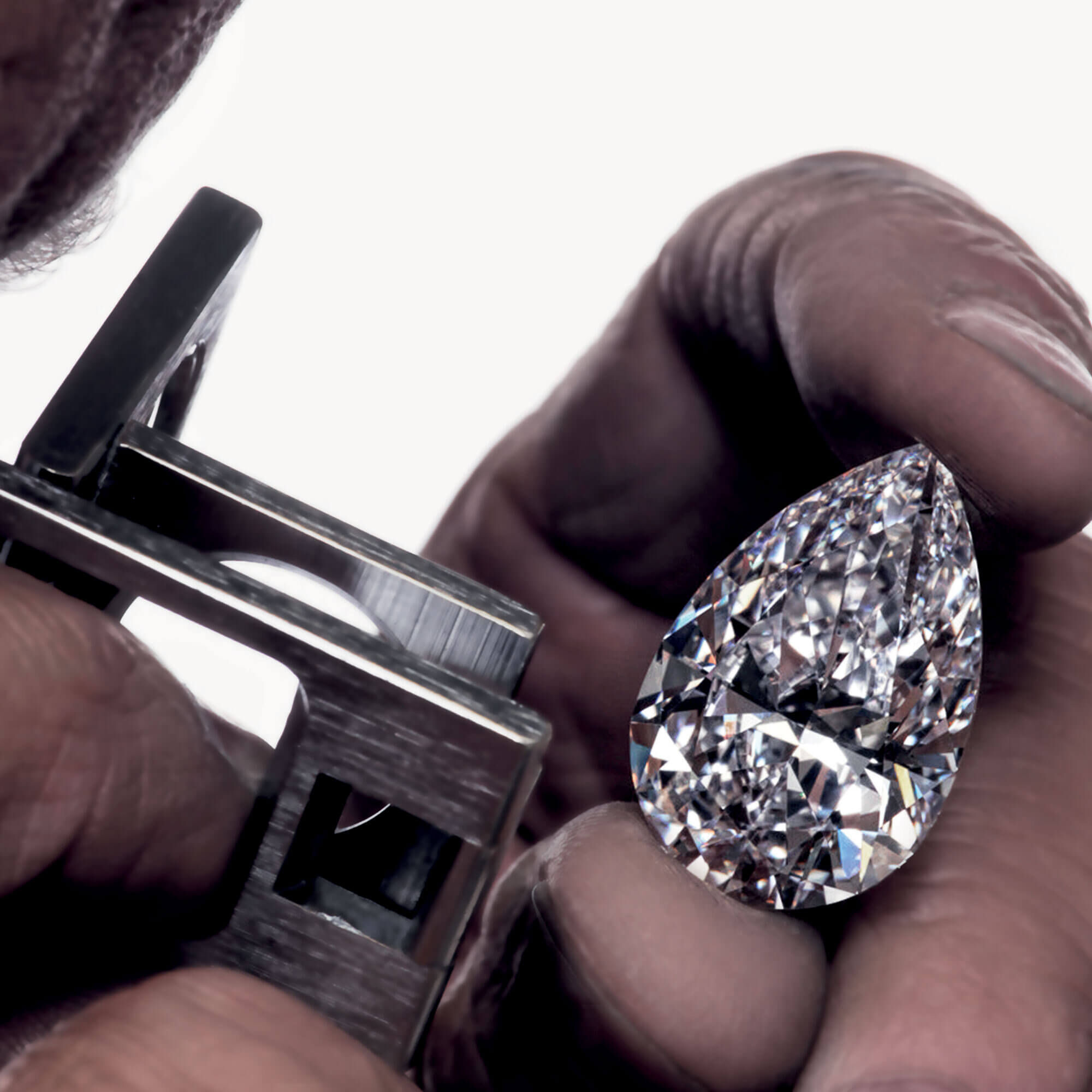 Close up of the Graff Vendôme pear shape diamond under examination