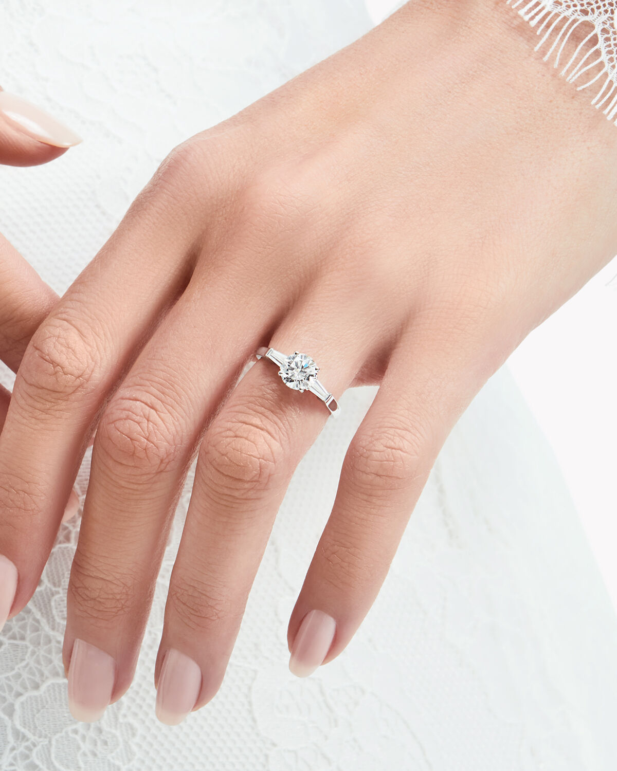 Close up of a model wearing a Graff Promise engagement ring