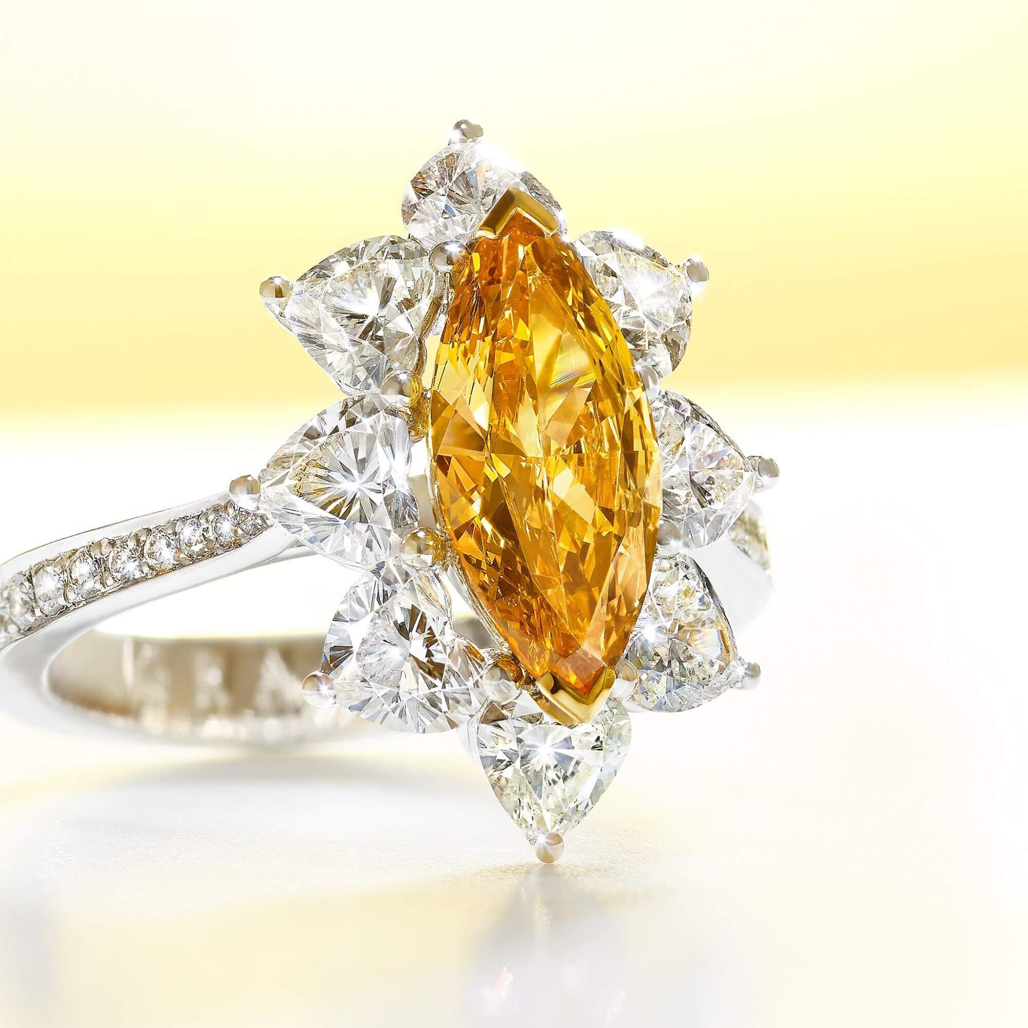 A 1 carat Fancy Vivid Yellow Orange marquise diamond Graff ring - GR50908