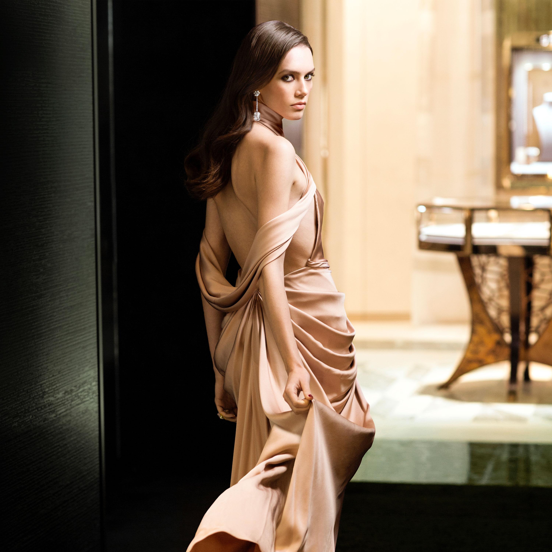 Model wears Graff diamond jewellery walking into a Graff boutique
