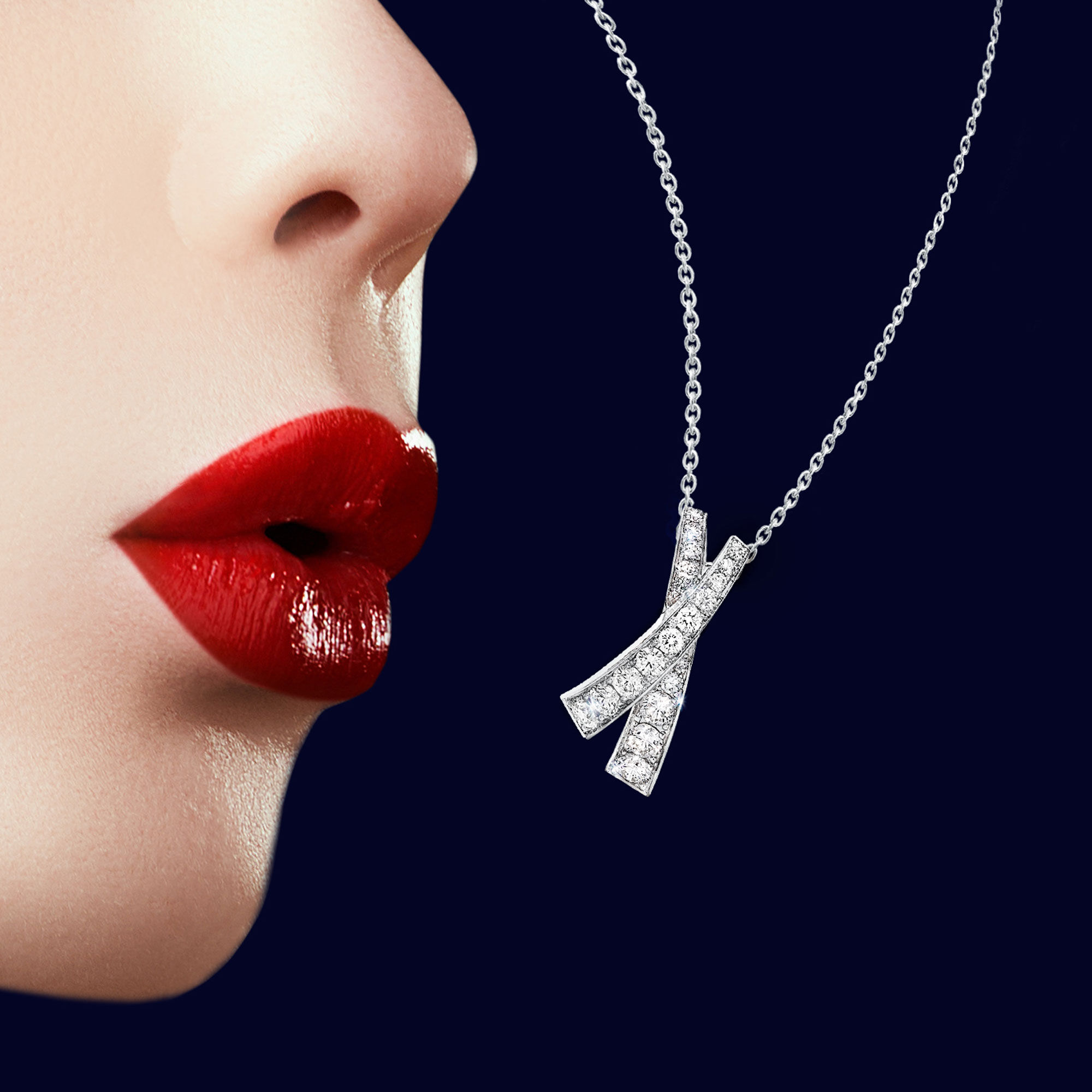 Close up of a model wears Graff Kiss collection diamond jewellery