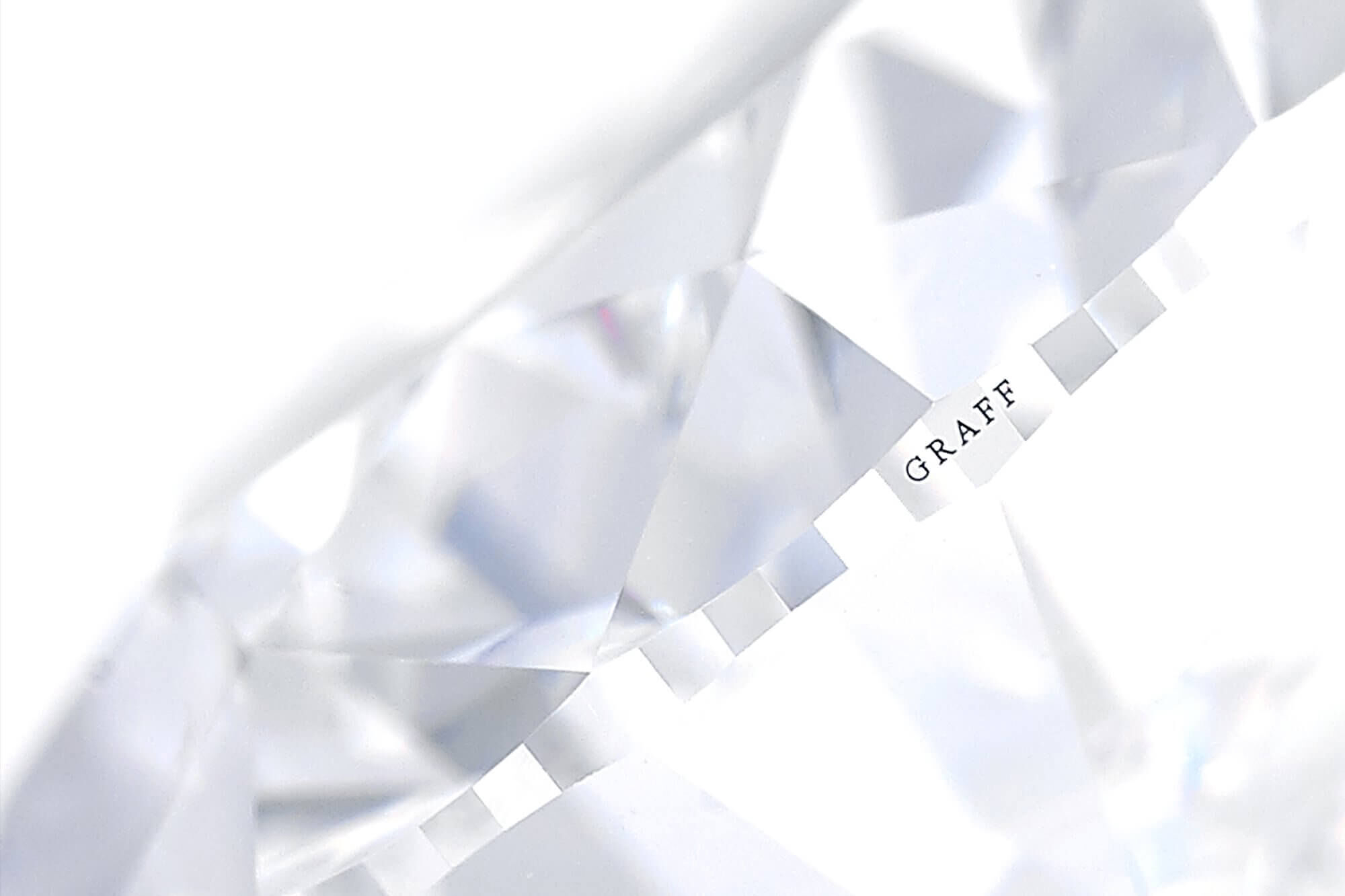 Close up of a Graff diamond with logo on the shank