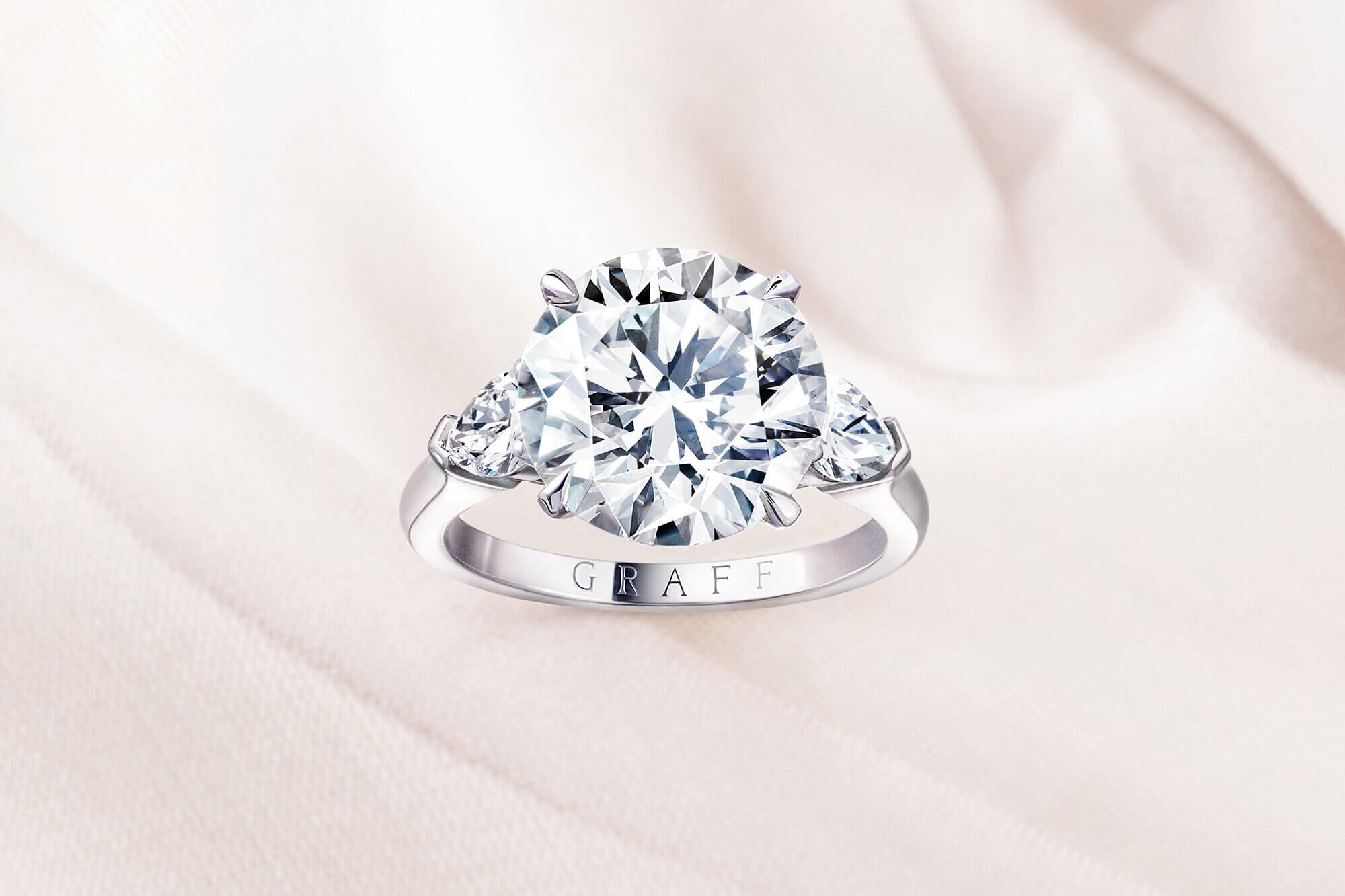 Close up of a Graff Promise round diamond engagement ring